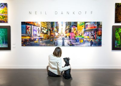 dog in art gallery viewing artwork
