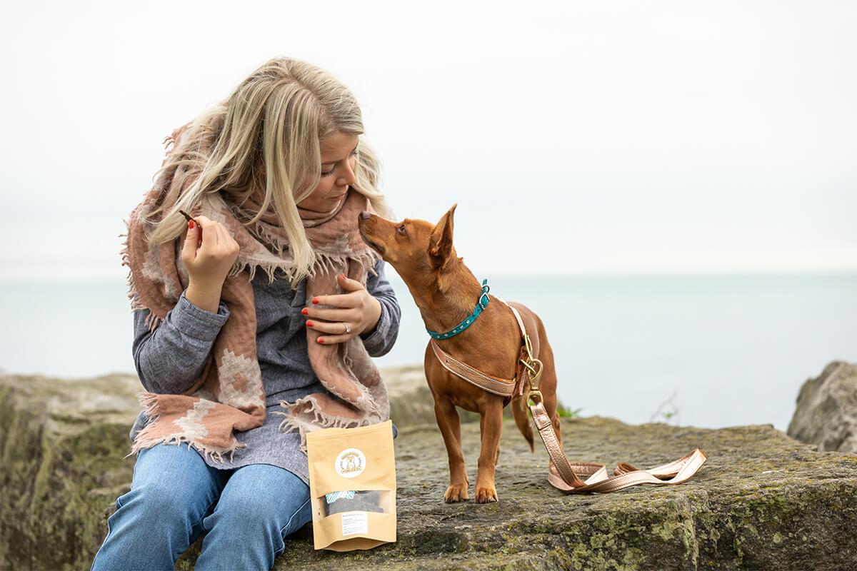 woman giving dog treats in Toronto