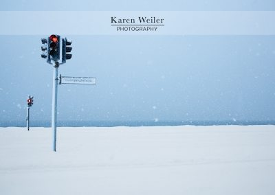 snow storm in Iceland with stoplight - fine art print
